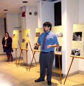Santo Mammone discusses the fall of the Berlin Wall as Emily Jarmolowicz looks on