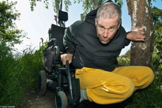 Neil Marcus outdoors with his wheelchair. Courtesy of Neil Marcus and Gary Ivanek.