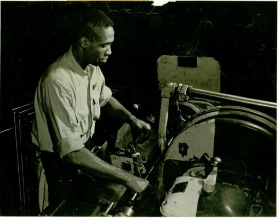 Charles C. Hill grinding a rifle barrel in an Armory machine shop, in 1943. Stanley Desmond said that when he started work as a machinist in 1940, he was the Armory's first black tool and die maker.