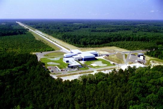 Figure 2: The LIGO site at Livingston, LA, showing one of its four-kilometer-long vacuum tube arms in full. Courtesy of LIGO.