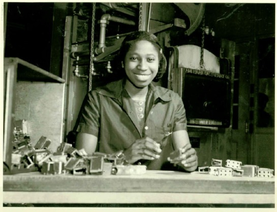 Priscilla Bryant inspects ammunition clips, one of the many skilled labor jobs that opened to African Americans and women as defense production ramped up.
