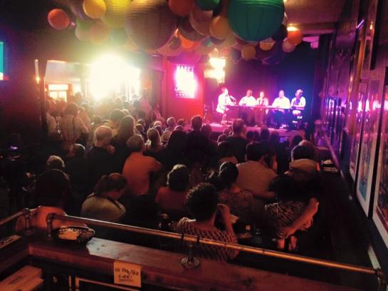 The crowd at The Happy Dog engrossed in a panel discussion about the history of the Hough Riots. Courtesy of the The Happy Dog.