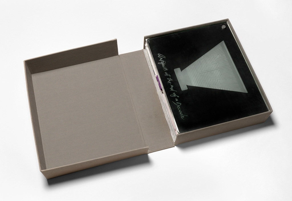 "An image of an opened archival box containing the artists Watson and Venezia-Huebner's portfolio ""Artifacts at the end of a Decade."""